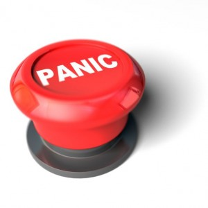 A red panic button isolated on a white background. 3D render with HDRI lighting and raytraced textures.